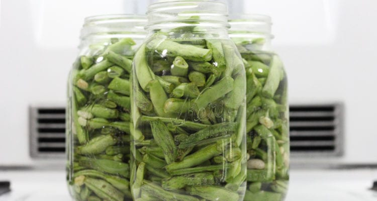 Showing green beans in jars