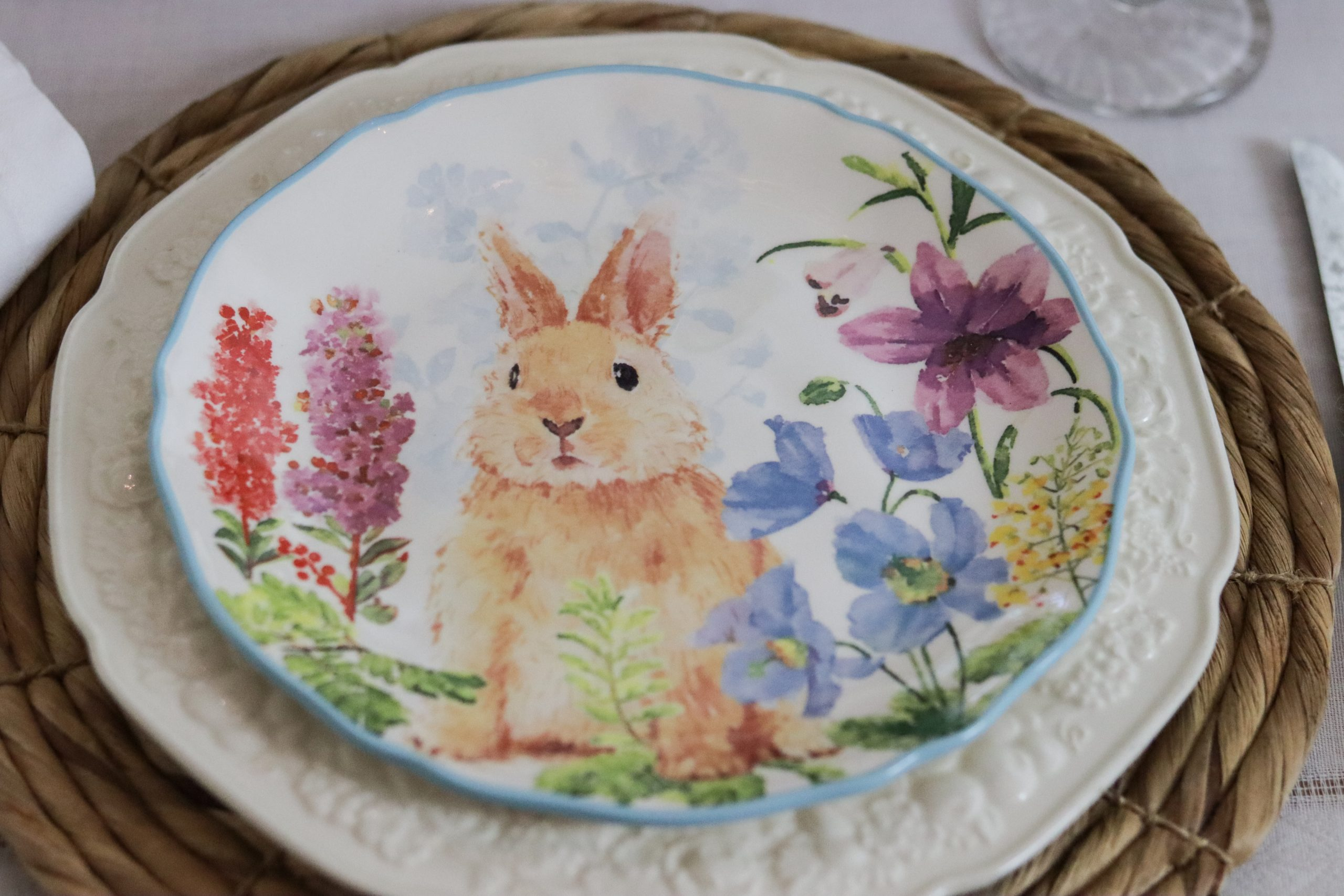 Showing natural charger, white ironstone plate and bunny plate.