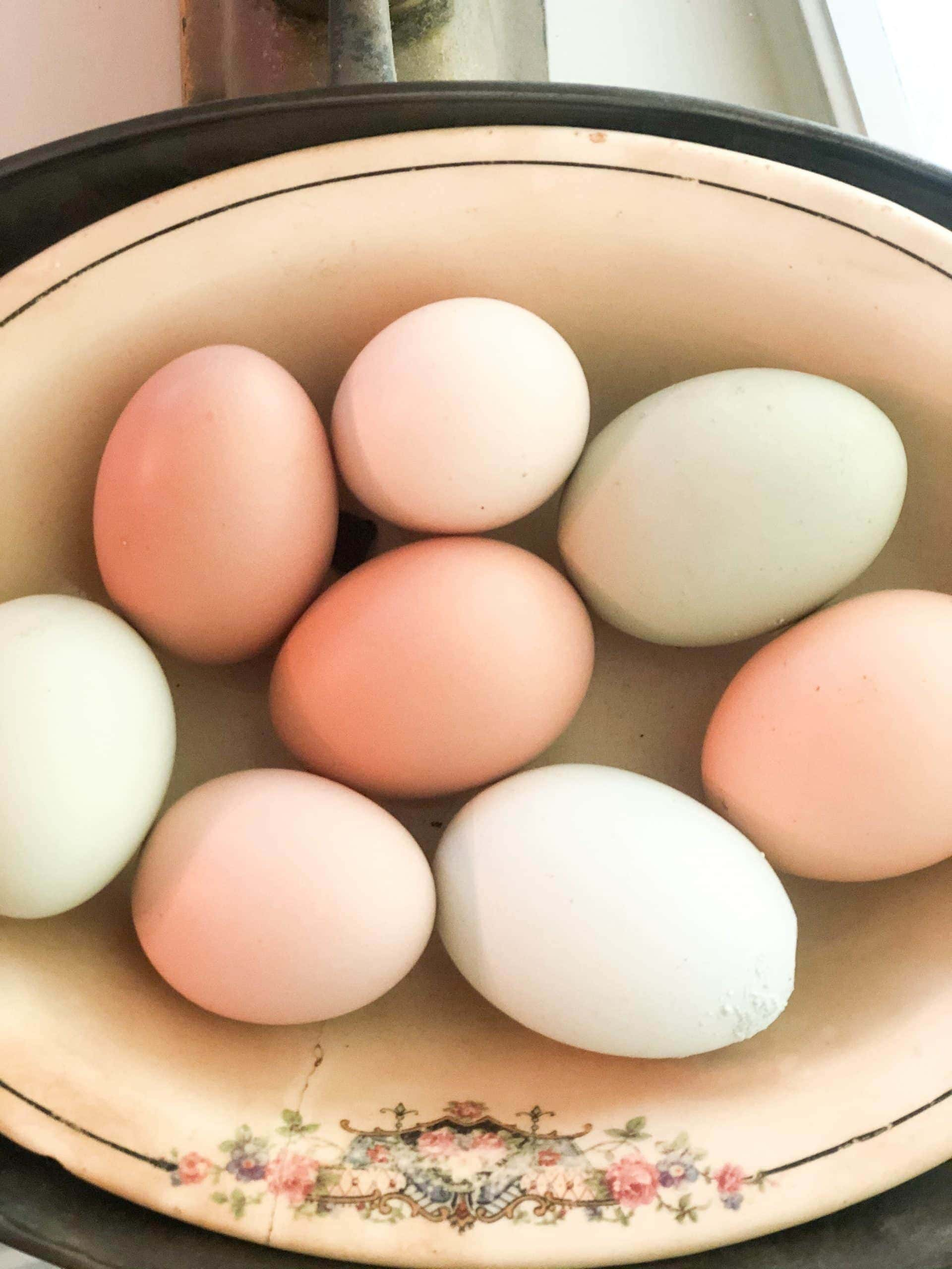 Colorful eggs in and antique bowl.