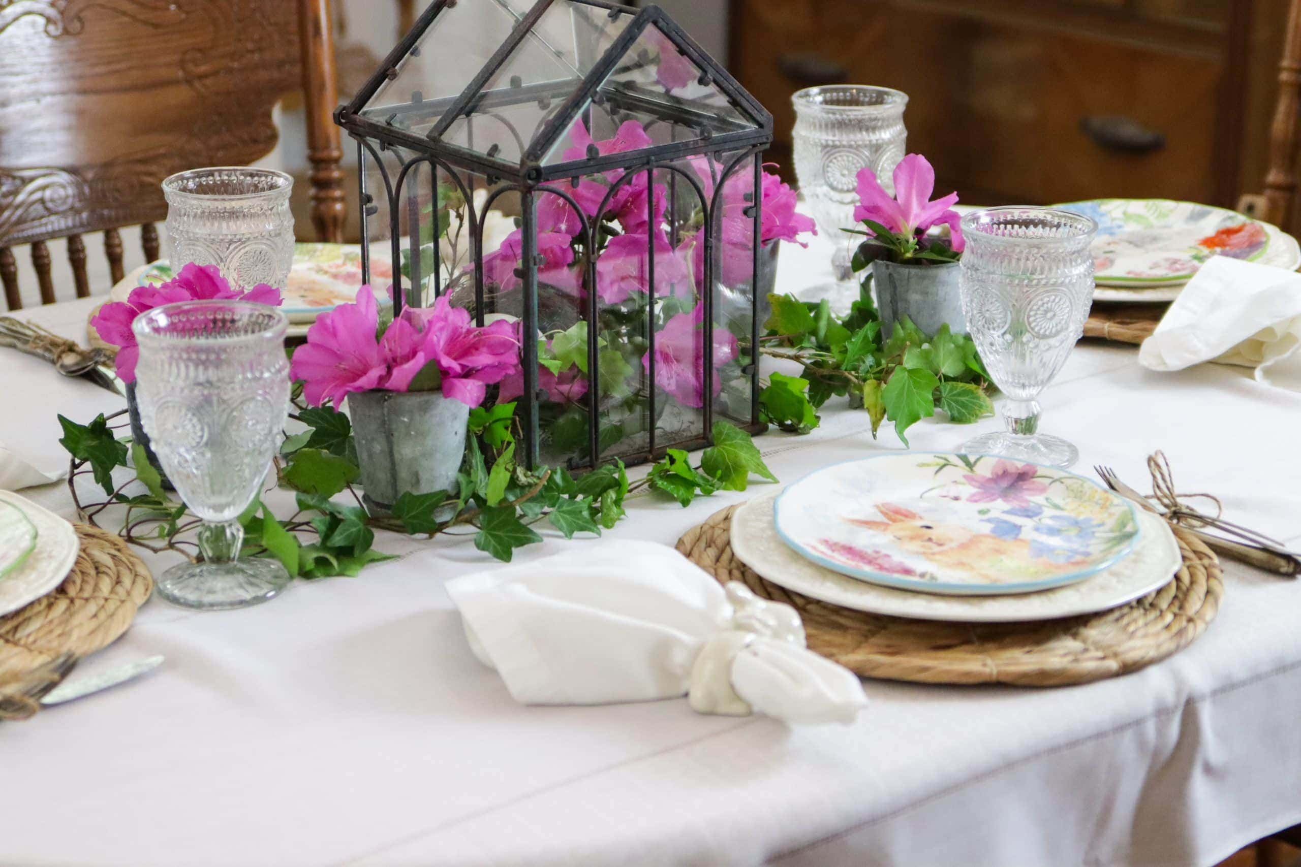spring table setting showing bunny napkin rings white table cloth white napkins bunny plates