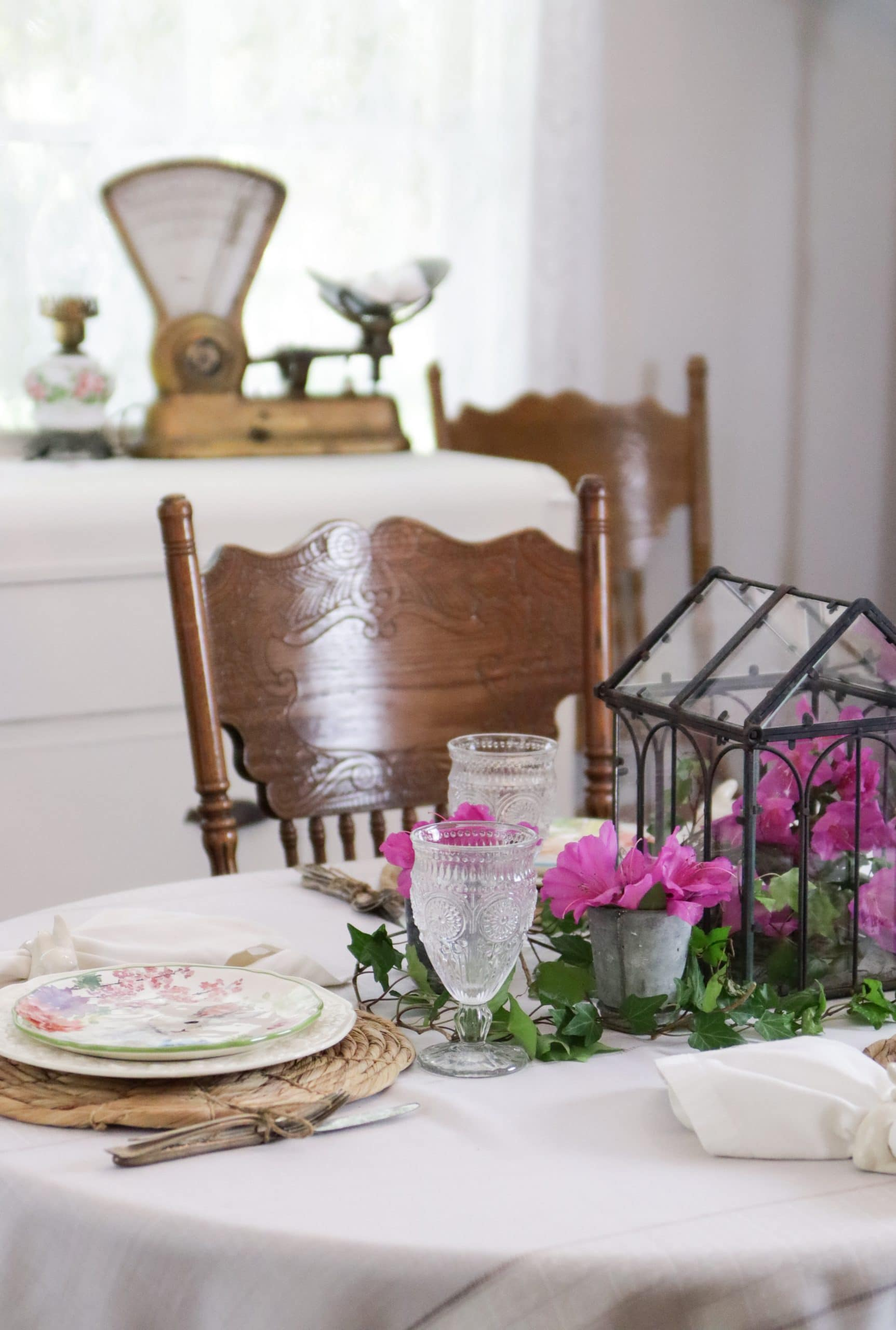 spring table setting with sideboard and old scale in background.